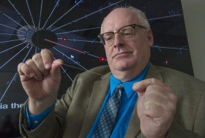 NASA engineer Bruce Wiegmann demonstrates the long, thin wires that will construct the E-Sail.