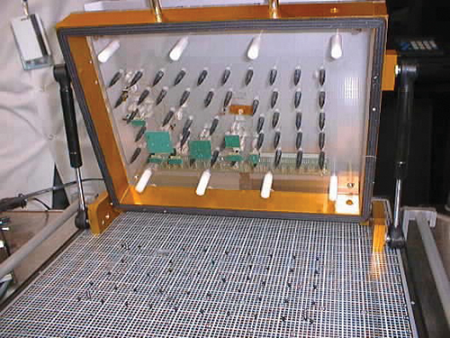 Figure 1: Typical ICT equipment with insulative down-holder pins